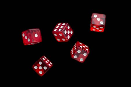 five falling translucent red dices with white dots on black background