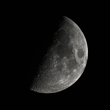 moon first quarter phase,  fifty percent lighted by the the sun, view from Northern Hemisphere, black background, taken with a 2500mm telescope focal lenght Stok Fotoğraf