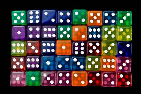many tranlucent multicolored dices in rows on black background