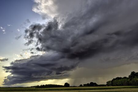Big summer rainy cloud over countryside, somewhere in France. Reklamní fotografie