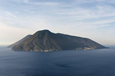 beautiful volcanic salina aeolian island, calm sea and blue cloudy sky background Archivio Fotografico