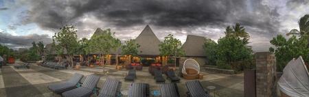 dark: Dark clouds over luxury beach resort Stock Photo