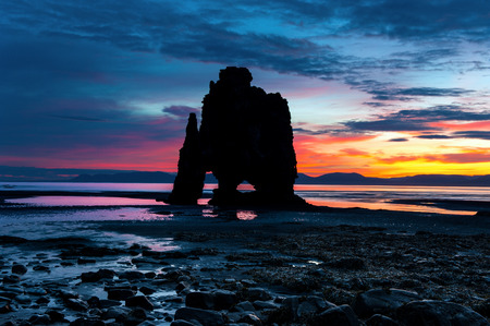 Silhouette of Hvitserkur at sunrise. A 15 m. high basalt stack situated in Vatnsnes peninsula, in the northwest of Iceland