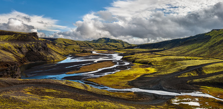Panorama of winding road and river through Icelandic landscape Stok Fotoğraf