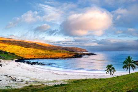 Anakena a white coral sand beach situated on the northern tip of Rapa Nui Easter Island is one of the only two small sandy beaches on the island the other one being Ovahe. Archivio Fotografico