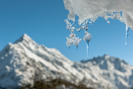 Icicle and distant mountain.