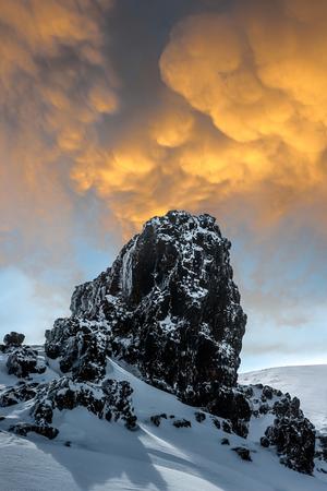 Rock, snow and sky. Stok Fotoğraf