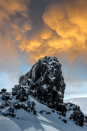 incredible: Rock, snow and sky. Stock Photo
