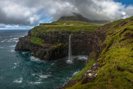 The village and waterfall of Gasadalur, Faroe Islands