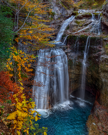 Waterfall Cave (Cave Fall), situated in the beautiful waterfall Arasas river in Ordesa NP, Spain. The exceptional beauty of the area is best appreciated in autumn When the surrounding forest turns into a kaleidoscope of vivid green, yellow, orange and red