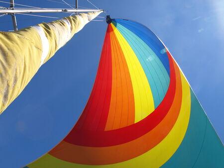 Colorful sail against a clear blue sky photo