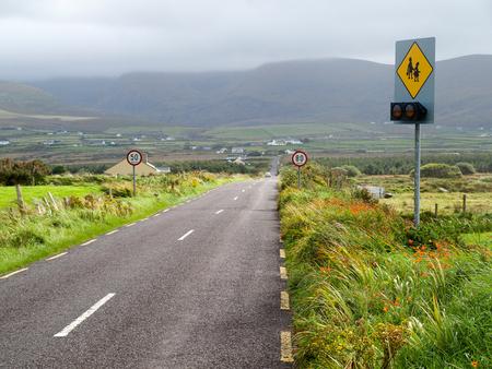 odd: Street with odd speed limits, Dingle peninsula, Ireland.