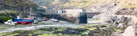 ebb: Fisherboats, lying on ground in Boscastle Harbour, Cornwall at ebb tide Stock Photo