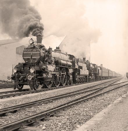 Old-fashioned steam locomotive in an austrian railway station.