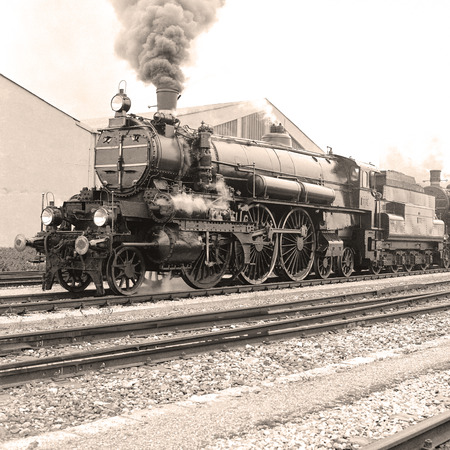 b w: Side view of an old-fashioned steam locomotive in a austrian railway station. Scan from a B & W negative. Editorial