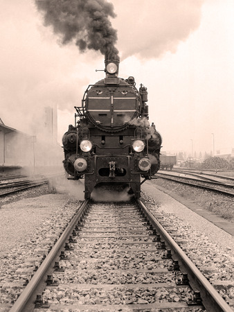 Front view of an old-fashioned steam locomotive in a austrian railway station. Scan from a B & W negative. photo