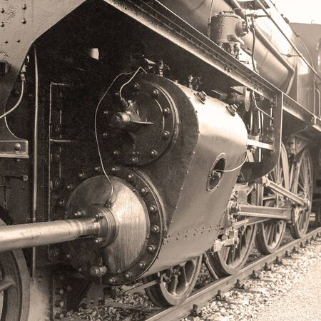 b w: Detail of an old-fashioned steam locomotive in a austrian railway station. Scan from a B & W negative. Stock Photo