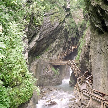 Wooden walkway in the Tscheppaschlucht in Carinthia in Austria. Old view back from 1999. Scan from a 6x6 negative.