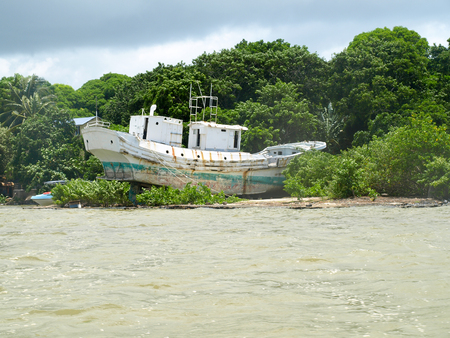 island: Ship wreck at the estuary of the Grand River South East in the eastern Part of Mauritius.