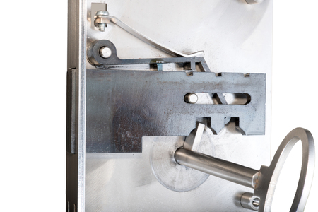 door bolt: View of the inside mechanism of a basic door lock with the locking bolt in the unlatched position. Sample with inserted key. Stock Photo