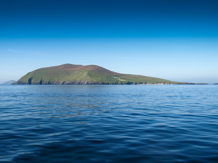 blasket islands: Blasket island, view from a fishing boat near the Slea Head on the Dingle Peninsula in Ireland with a clear deep blue sky Stock Photo
