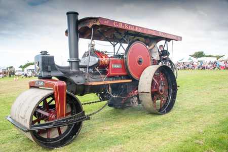 steam roller: ST MAWGAN, CORNWALL - SEPTEMBER 17, 2016: Vintage steam roller named  Smokey at the  St Mawgan Steam and Vintage Rally. Editorial