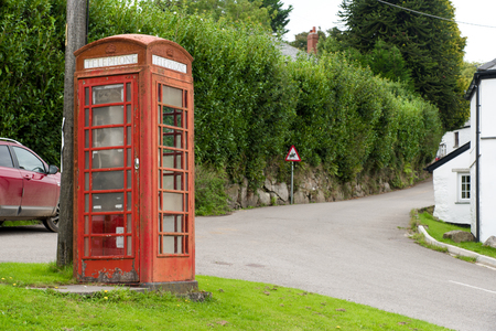 bodmin: Weather-beaten red phone box in Henwood on the edge of the Bodmin Moor in Cornwall.