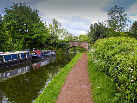 Bridge with towpath and mooring narrowboats in Penkridge on the Staffordshire and Worcestershire canal