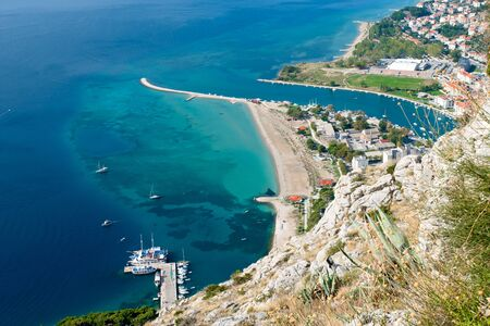 View to Omis from the Starigrad Fortress with the river Cetina, the town and the adriatic sea.