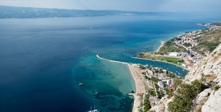 View to Omis from the Starigrad Fortress with the river Cetina, the town, the adriatic sea and in the background the island of Brac.