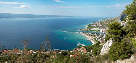 View to Omis from half the way to the Starigrad Fortress with the river Cetina, the town, the adriatic sea and in the background the island of Brac. Stock Photo