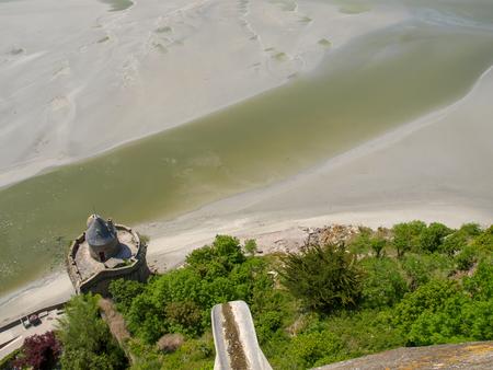 Sandy beach, view from a walk around Mont Saint Michel. Stock Photo