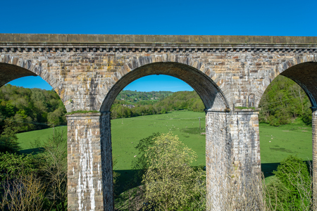 View of the Chirk railway viaduct from a narrowboat on the Chirk Aquaduct. The later built Railway viaduct runs alongside the navigable aquaduct.