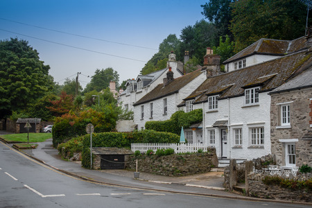White cottages in the historic fishing village Polperro in Cornwall, UK Banco de Imagens