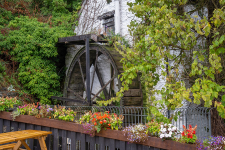 Restored waterwheel from at 14th century Inn and Mill at the entrance to the Village of Polperro in Cornwall, England.
