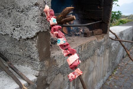 In Madeira the typical espetada is beef in a bay laurel skewer, seasond with salt, pepper, garlic and bay leafs. It is then cooked over hot charcoal or a log fire.