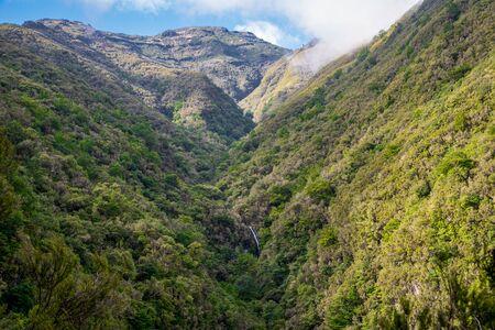 Caldeirao Verde waterfall with mountain landscape on the Levada Caldeirao Verde near Santana on the island of Madeira, Portugal.