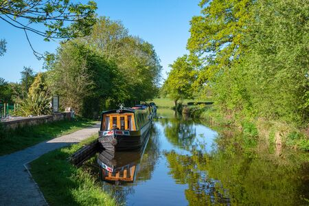 Moored narrowboats on the LLangollen Canal near Chirk in Wales.