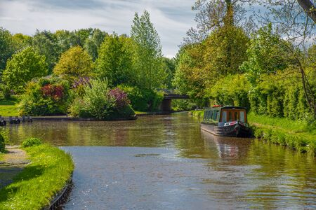 Scenic canal view with mooring narrowboat on the Llangollen Canal near Chirk, Wales,UK