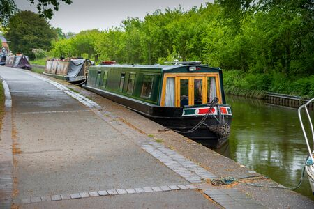 Scenic canal view with a mooring narrowboatonf the Llangollen Canal in Ellesmere, Wales,UK