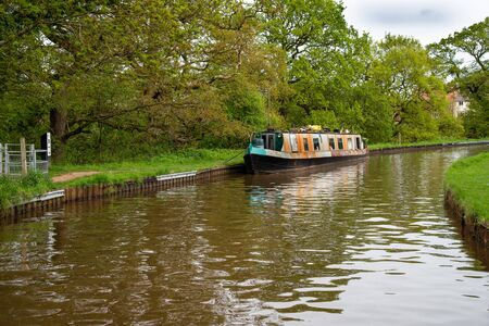 Scenic canal view with mooring narrowboats on the Llangollen Canal near Whitchurch, Shropshire, UK