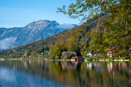 Traditional houses in early autumn on the shoreline of the lake Grundlsee, Styria, Austria.