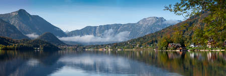 Autumn morning with patches of fog on the lake Grundlsee, Styria, Austria.