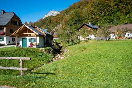 Traditional houses in early autumn near the lake Grundlsee, Styria, Austria.