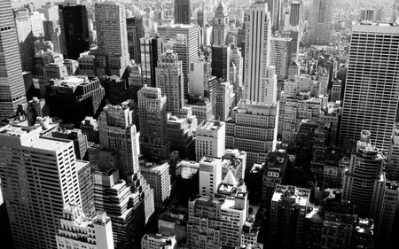 A cityscape picture of Manhattan in a perspective from above in black and white  photo