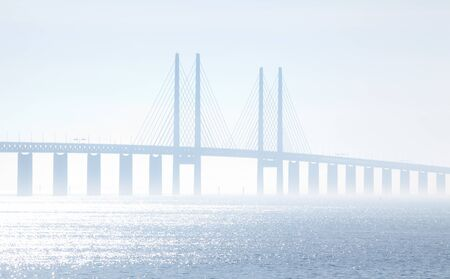 The Oeresundsbridge between Sweden and Denmark on a foggy day  photo