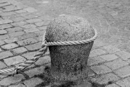 anchoring: A closeup shot of a rope anchoring, showing its detail in black and white