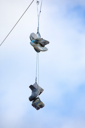 powerline: Detail of shoes tossed over a powerline