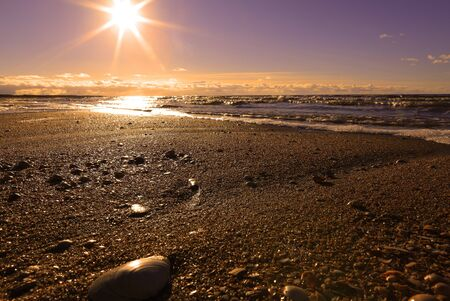 A beach drenched in sunshine on a warm summer day Stock Photo - 22422537