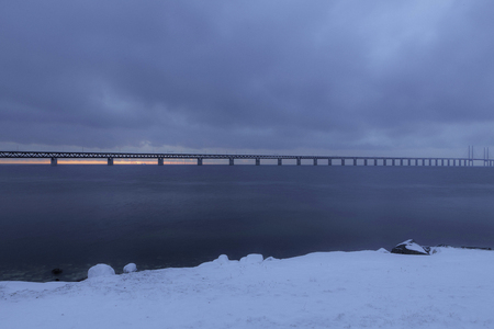 A picture of the Oeresundsbrigde between Denmark and Sweden, on a winter evening  photo